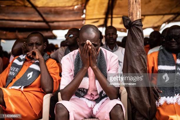 Prisoners listen during a Genocide commemoration ceremony on April 07, 2019 at Nyarugenge Prison in Kigali, Rwanda. The prison holds many...