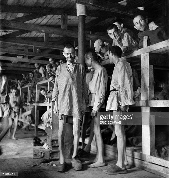 Prisoners look at the photographer in block 61 of Buchenwald concentration camp in April 1945 The construction of Buchenwald camp started 15 July...