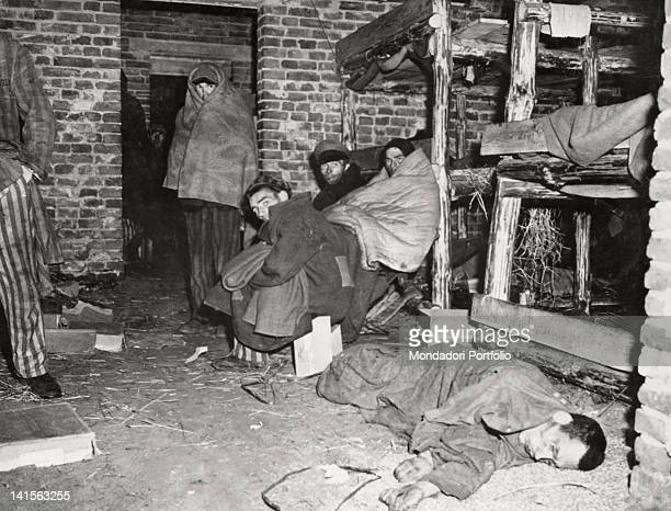 Prisoners lying down in a hut in a Nazi concentration camp.