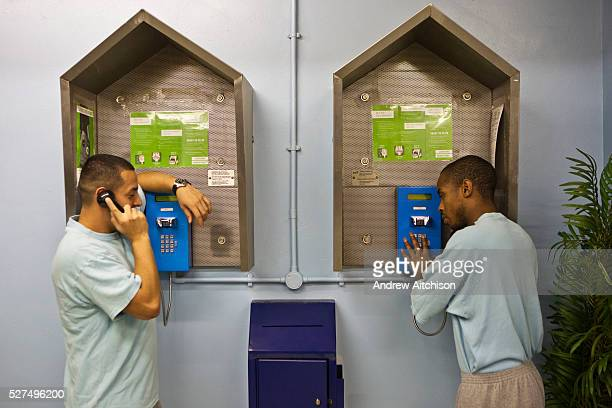 Prisoners make calls to family members from the pay phones on the E wing of HMP Wandsworth London United Kingdom