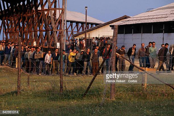 Prisoners Musulmans et croates of War in Serbian Military Camp Prisoners of war sit in a former stable at Manjaca converted into A Serbian military...