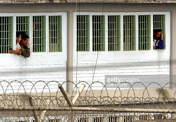 Prisoners observe police after at least eight inmates were killed and another 12 injured in clashes between leftist rebels rightwing paramilitaries...