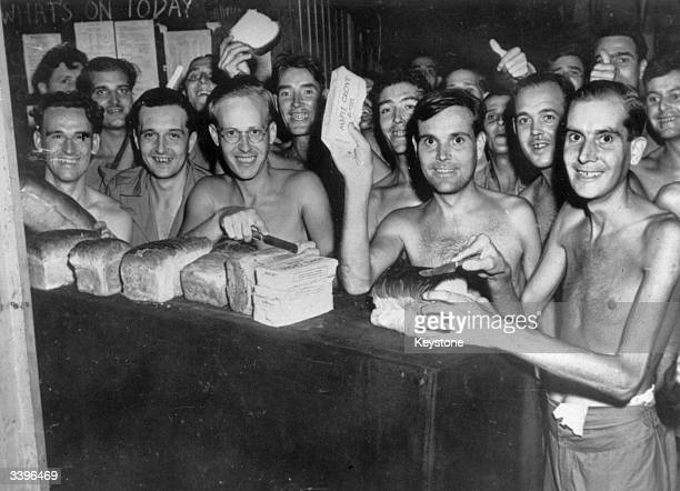 Prisoners of War from the Allied forces eating food after being liberated from a Japanese Prisoner of War camp in Taiwan