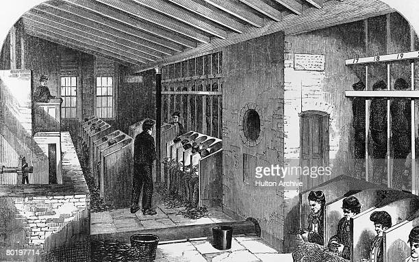 Prisoners on a treadmill and picking oakum in the oakum shed at Holloway Prison London 1862 Oakum picking involves teasing out old tarred rope to be...