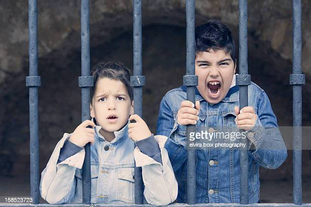 prisoners - child behind bars stock pictures, royalty-free photos & images