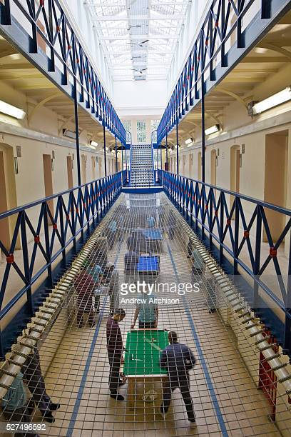 Prisoners play pool and socialise during a recreation period on C wing at the Young Offender Institution Aylesbury United Kingdom