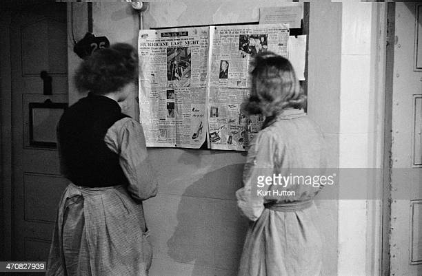 Prisoners read one of the newspapers pinned up by the chaplain at Holloway Prison north London March 1947 The copy of the Daily Mail pictured leads...