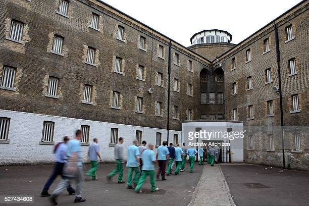 Prisoners return from their jobs to their wings for lunch at Wandsworth prison HMP Wandsworth in South West London was built in 1851 and is one of...