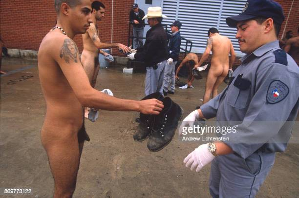 Prisoners returning from field work on the prison farm are strip searched before reentering the prison on May 15 1997 at the Hughes Unit in Gatesvile...