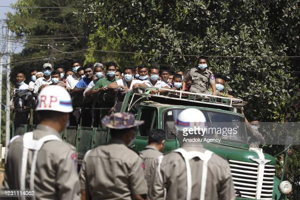 Prisoners ride on a truck while they released from Insein Prison with military Chief Senior Gen. Min Aung Hlaings announcement, Friday, February 12...