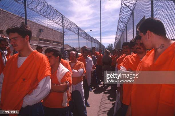 Prisoners sit in the heat of the Arizona desert in army tents in Maricopa County Sheriff Joe Arpaio's tent city jail on April 14 1995 in Phoenix...