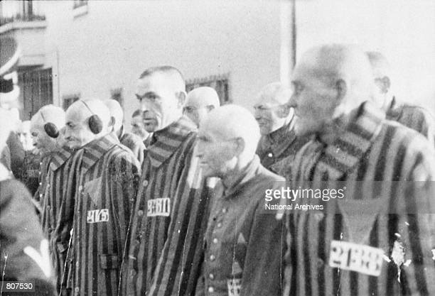 Prisoners stand in lines outdoors in the concentration camp at Sachsenhausen Germany December 19 1938
