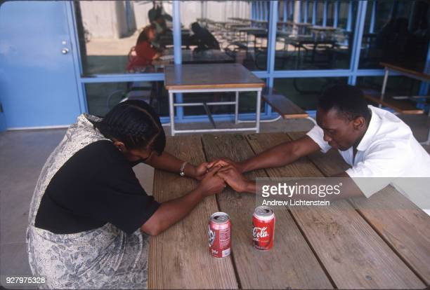 Prisoners visit with their families during visiting day at the Hughes Unit a Texas state prison on June 15 1997 outsides of Gatesville Texas