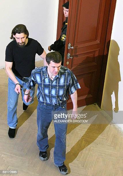 Prisoners Vitaly Akishin and Yuri Kolchin leave a court hall in StPetersburg 30 June 2005 StPetersburg court sentenced the organizer of State Duma...