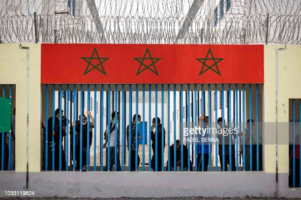 Prisoners wait for their turn to receive a dose of the AstraZeneca jab against the coronavirus, during a vaccination campaign at the El-Arjate prison...