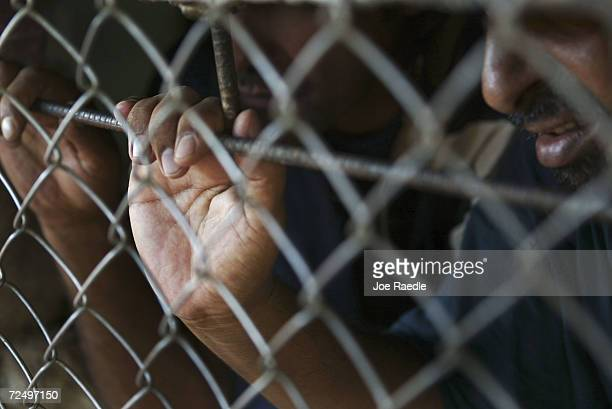 Prisoners wait in a cell to be processed for release from Abu Ghraib prison on July 15 2004 west of Baghdad Iraq The US army released 65 prisoners...