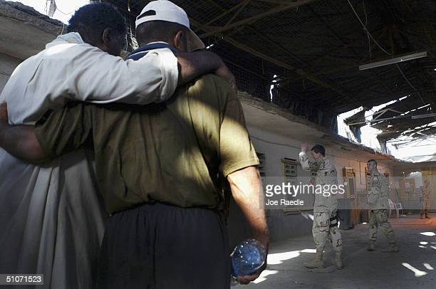 Prisoners wait together to be release from Abu Ghraib prison July 15 2004 west of Baghdad Iraq The US army released 65 prisoners that were picked up...