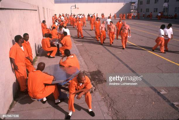 Prisoners walk the yard at the San Quentin prison on May 15 1999 in San Quentin California