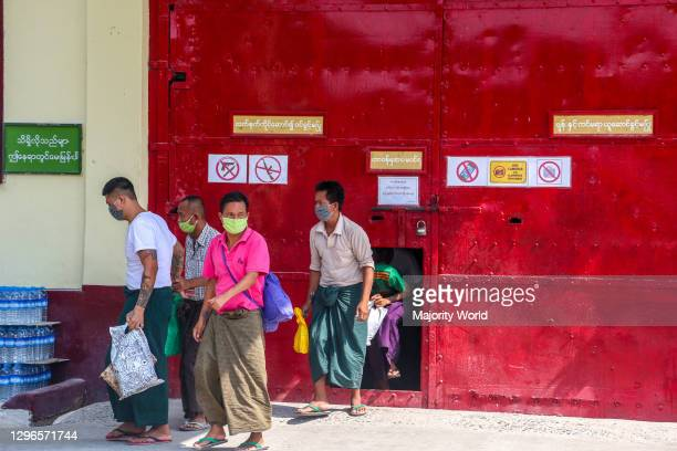Prisoners who are released are coming out from the Obo prison in Mandalay, Myanmar.