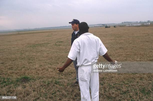 Prisoners work the fields of the Ferguson Unit's prison farm on January 15 1997 in Midway Texas