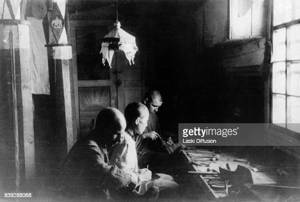 Prisoners working in the cobbler's workshop in the Vorkuta Gulag one of the major Soviet labor camps Russia Komi Republic 1945