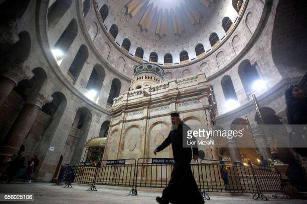 A prist walks outside The tomb of Jesus Christ in the Church of the Holy Sepulchre on March 21 2017 in Jerusalem Israel The tomb of Jesus Christ in...