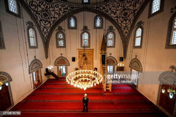 TOPSHOT Pristina Grand Mosque's imam Bahri Sejdiu holds the Friday prayers alone in the Grand Mosque in Pristina on April 24 on the first day of the...