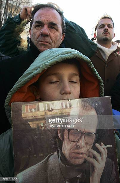 A boy holds a picture of the late Kosovo President Ibrahim Rugova during his funeral ceremony in centre of Pristina 26 January 2006 Rugova was...