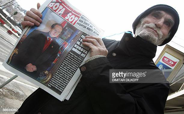 A Kosovo Albanian holds a newspaper with a picture of the late Kosovo President Ibrahim Rugova in centre of Pristiana 22 January 2006 Rugova whose...