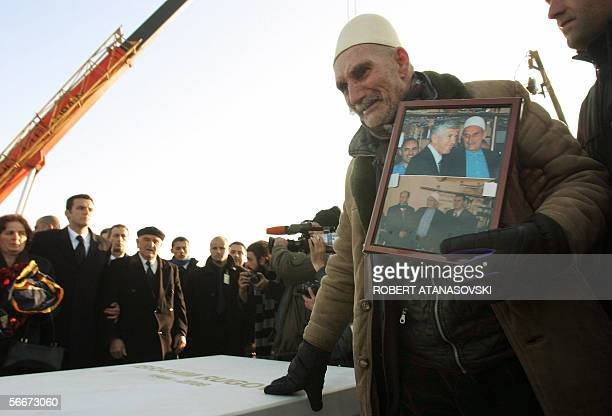 An elderly Kosovo Albanian cries on the grave of late Kosovo president Ibrahim Rugova during his funeral ceremony in Pristina 26 January 2006 Rugova...