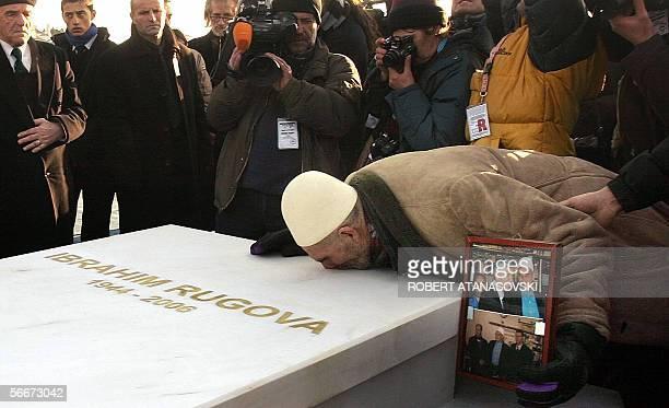 An elderly Kosovo Albanian kIsses the grave of late Kosovo President Ibrahim Rugova during his funeral ceremony in Pristina 26 January 2006 Rugova...