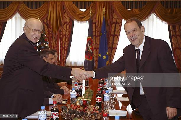 EU foreign policy chief Javier Solana shakes hands with Kosovo President Ibrahim Rugova 06 December 2005 during his meeting with Kosovo Albanian...