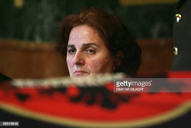 Fana Rugova the wife of late Kosovo President Ibrahim Rugova stands near her husband's coffin in the parliament in Pristina 23 January 2006 where it...