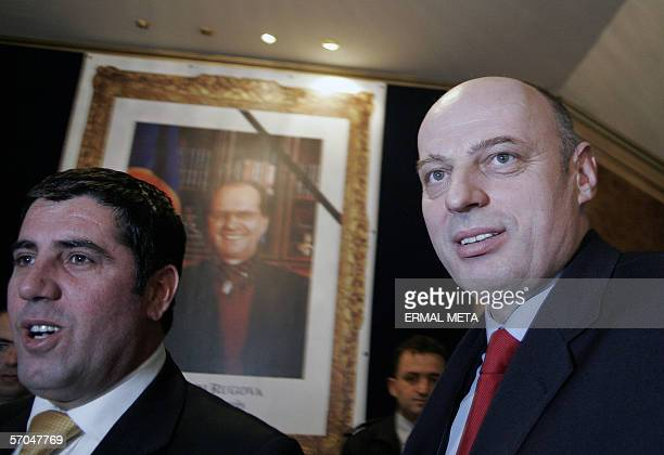 Former guerrilla commander Agim Ceku walks past a portrait of late Kosovo President Ibrahim Rugova in the Kosovo Parliament after his election as...