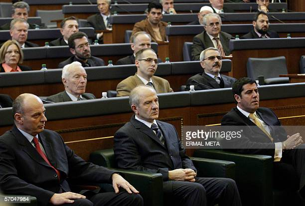 Former guerrilla commander Agim Ceku listens to a speech in the Kosovo Parliament before his election as Kosovo prime minister 10 March 2006 Deputies...