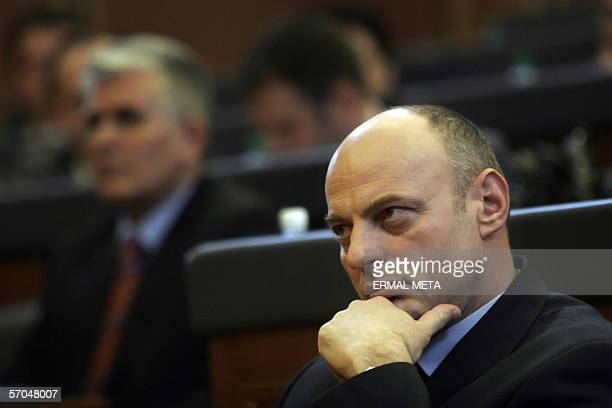 Pristina, SERBIA AND MONTENEGRO: Former guerrilla commander Agim Ceku talks listens to a speech in the Kosovo Parliament before his election as...