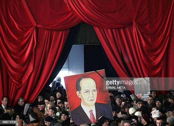 Kosovo Albanians carry a picture of late Kosovo President Ibrahim Rugova during his funeral ceremony in Pristina 26 January 2006 Rugova was...