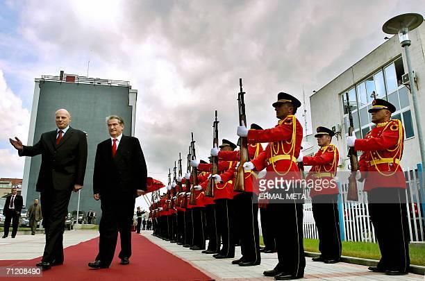 Kosovo's Prime Minister Agim Ceku and Albanian Prime Minister Sali Berisha inspect the honour guard in Kosovo's capital Pristina 15 June 2006 Berisha...