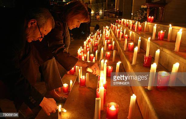 Ethnic Albanian Kosovars light candles to pay their respects to late Kosovo's President Ibrahim Rugova on the first anniversary of his death 21...