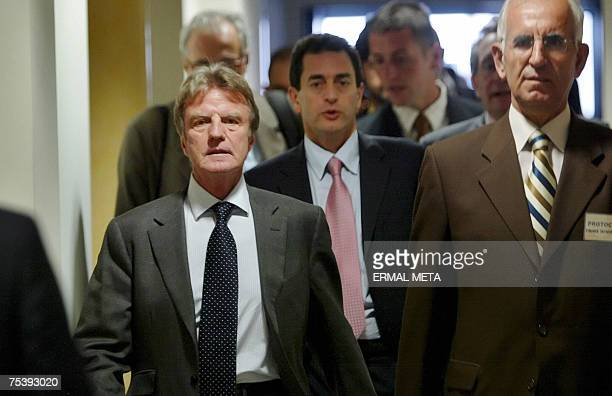 French Foreign Minister Bernard Kouchner arrives with unidentified officials to a meeting with Kosovo's Prime Minister Agim Ceku , 13 July 2007, in...