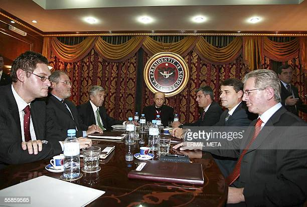 Kosovo President Ibrahim Rugova surrounded by Kosovo ethnic Albanian leaders sit at the negociation table 06 October 2005 in Pristina They said...