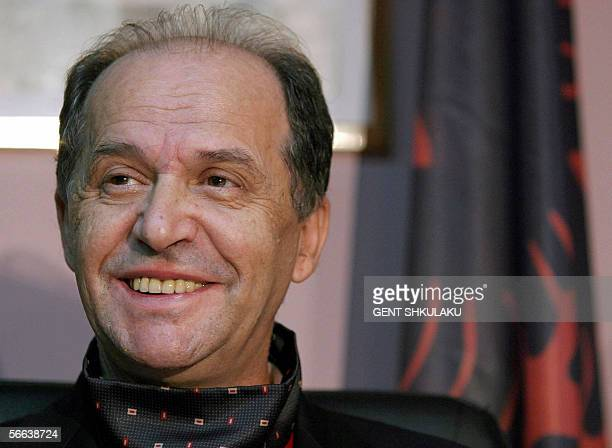 Kosovo's President Ibrahim Rugova smiles during a press conference in Pristina 24 October 2004 after he declared victory in Kosovo's general...