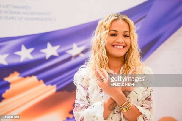 Pristinaborn British singer and actress Rita Ora gestures as she makes a sign depicting double headed eagle as shown in the Albanian national flag...