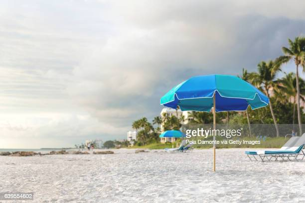 pristine and idyllic beach at sunset in a bright day, naples, florida, usa - sunshade stock pictures, royalty-free photos & images