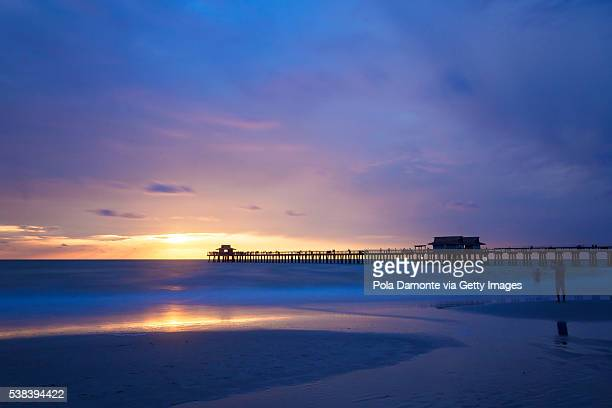 Pristine and idyllic beach at sunset, with a blue sky, Naples, Florida, USA