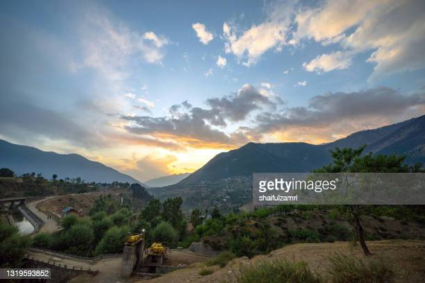 pristine river over beautiful mountain landscape of naranag - shaifulzamri stock pictures, royalty-free photos & images