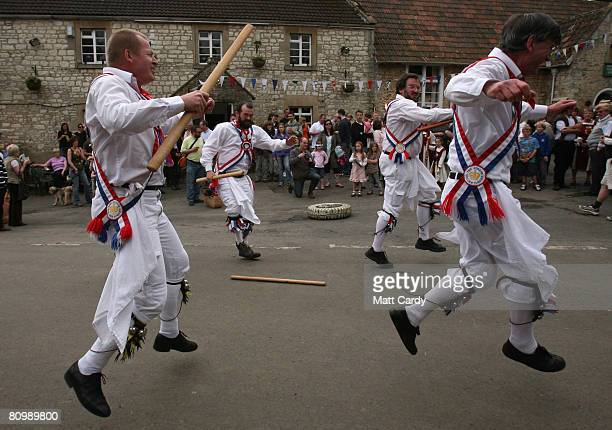 Priston Jubilee Morris Men dance outside the village pub and hall at the May Day village celebrations in Priston on May 5 2008 in Somerset England...