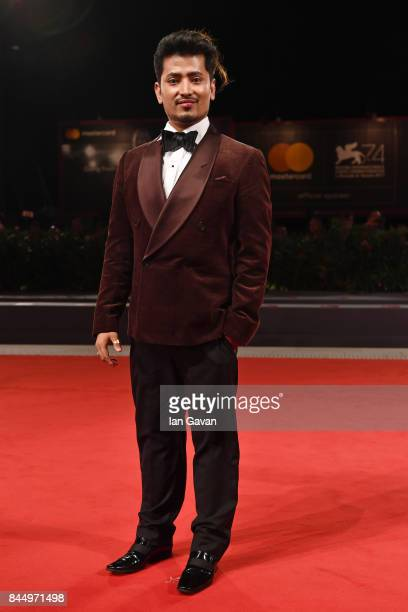 Pritan Ambroase walks the red carpet ahead of the 'Outrage Coda' screening during the closing night of the 74th Venice Film Festival at Sala Grande...