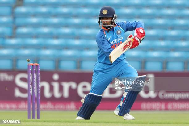 Prithvi Shaw of India A guides the ball through the offside during a tour match between ECB XI v India A at Headingley on June 17 2018 in Leeds...