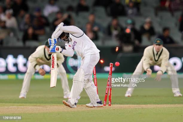 Prithvi Shaw of India is bowled by Pat Cummins of Australia during day two of the First Test match between Australia and India at Adelaide Oval on...